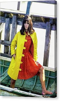 Model On A Boat In A Yellow Over Coat And A Red Canvas Print