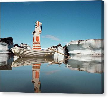 Model Standing On A Boat On The Vatnajokull Canvas Print by John Cowan