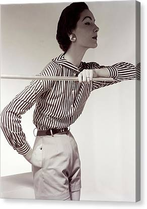 Model Wearing A Nelly De Grab Shirt And Shorts Canvas Print by Horst P. Horst