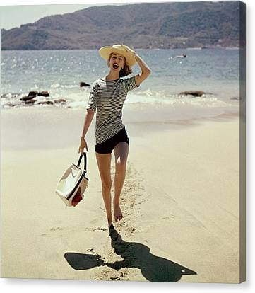 Model Wearing A Straw Hat On A Beach Canvas Print