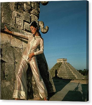 Model Wearing An Ivory And Gold Jumpsuit Canvas Print