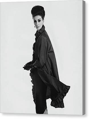Adele Canvas Print - Model Wearing Ruffled Raincoat by Karen Radkai