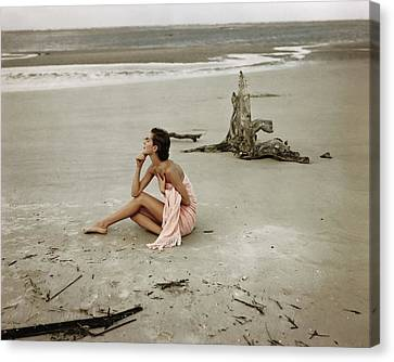 Chin On Hand Canvas Print - Model Wrapped In A Pink Towel On The Beach by Frances McLaughlin-Gill