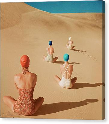 Models Sitting On Sand Dunes Canvas Print by Clifford Coffin