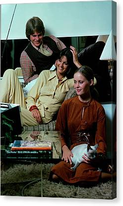 Models Watching Television Canvas Print by William Connors