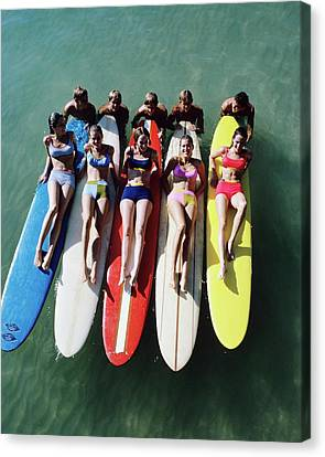 Models Wearing Bikinis Lying On Surfboards Canvas Print