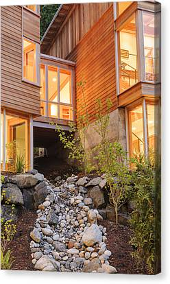 Modern House And Rocky Creek Canvas Print by Will Austin
