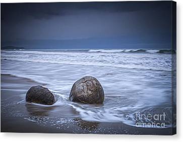 Moeraki Boulders And Waves Canvas Print by Colin and Linda McKie