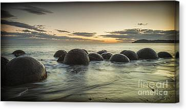 Moeraki Boulders New Zealand At Sunrise Canvas Print by Colin and Linda McKie