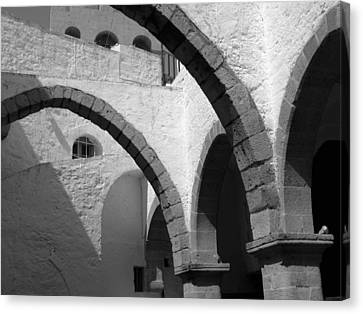 Monastery Arches Canvas Print by Larry Bohlin