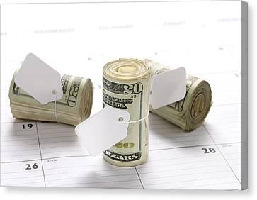 Money Rolls On Calendar Canvas Print by Joe Belanger