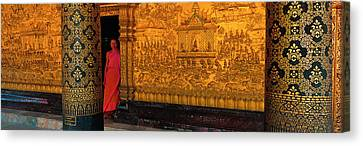Monk In Prayer Hall At Wat Mai Buddhist Canvas Print by Panoramic Images