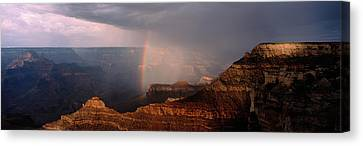Monsoon Storm With Rainbow Passing Canvas Print by Panoramic Images