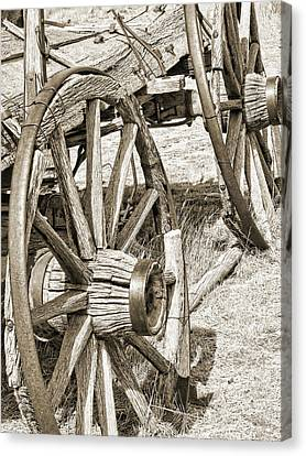 Montana Old Wagon Wheels In Sepia Canvas Print by Jennie Marie Schell