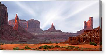 Monument Valley Canvas Print - Monument Valley At Sunset Panoramic by Mike McGlothlen