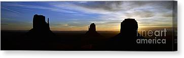 Monument Valley Desert Sunrise And Butte Silhouettes Panoramic Canvas Print by Shawn O'Brien