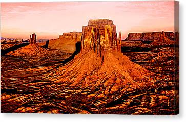 Monument Valley Sunset Canvas Print by Bob and Nadine Johnston