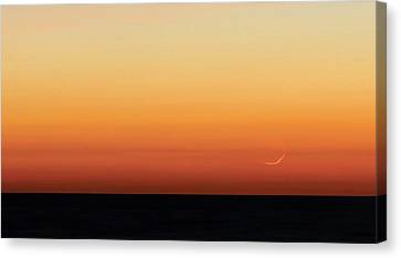 Moon At Sunrise Over The Sea Canvas Print by Luis Argerich