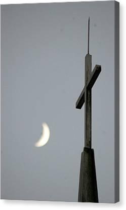 Moon Cross Canvas Print by Beverly Hammond