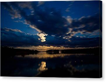 Moon Glow Canvas Print by Greg DeBeck