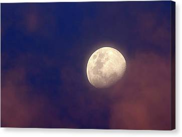 Moon In Clouds Canvas Print by Luis Argerich