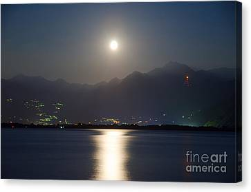 Moon Light Over A Lake Canvas Print by Mats Silvan