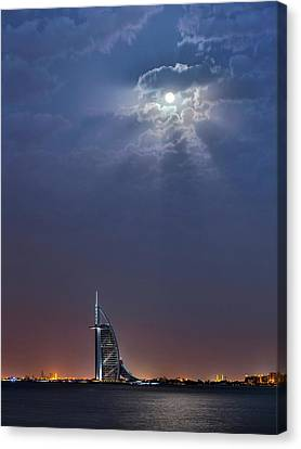 Moon Over Burj Al Arab Hotel Canvas Print by Babak Tafreshi