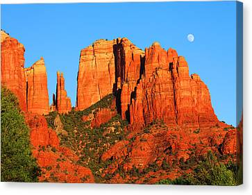 Canvas Print featuring the photograph moon Over Cathedral by Tom Kelly