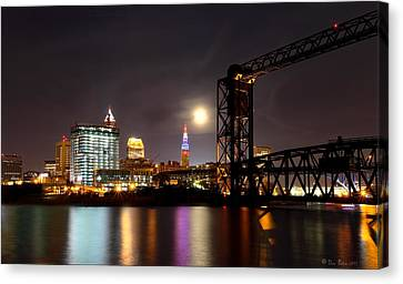 Canvas Print featuring the photograph Moon Over Cleveland by Daniel Behm