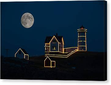 Moon Over Nubble Light Canvas Print by Guy Whiteley