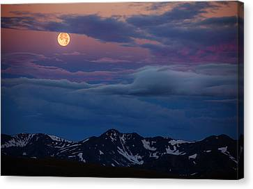 Moon Over Rockies Canvas Print by Darren  White