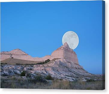 Moon Over The Monument Canvas Print by HW Kateley