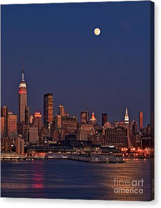 Moon Rise Over Manhattan Canvas Print by Susan Candelario