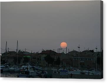 Moon Rising Over Carol South France Canvas Print by Phoenix De Vries