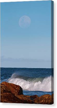 Moon Rising Over The Sea Canvas Print by Luis Argerich
