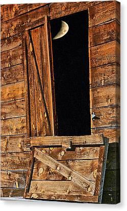 Moon Through The Barn Door Canvas Print
