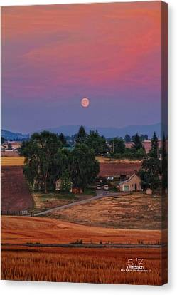 Moonrise At Sunset Canvas Print by Dan Quam