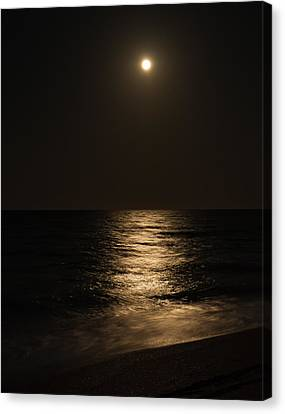 Moon Over Water Canvas Print by John M Bailey