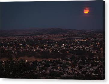 Moonrise Over Paso Canvas Print by Tim Bryan