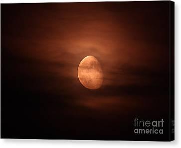 Waning Moon Canvas Print - Moonrise Through Clouds by John Chumack