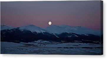 Moonset Over The Great Divide Canvas Print by Patrick Derickson