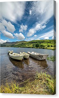 Moored Boats  Canvas Print by Adrian Evans