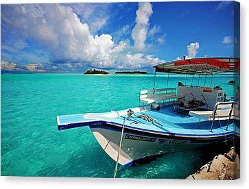Moored Dhoni At Sun Island. Maldives Canvas Print by Jenny Rainbow