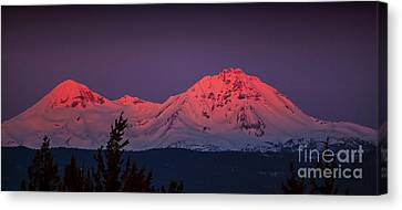 Morning Dawn On Two Of Three Sisters Mountain Tops In Oregon Canvas Print by Jerry Cowart