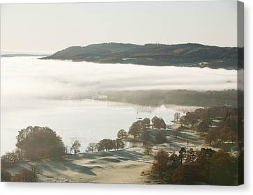 Morning Mist Over Lake Windermere Canvas Print by Ashley Cooper