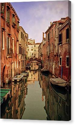 Morning Reflections Of Venice Canvas Print by Cliff Wassmann