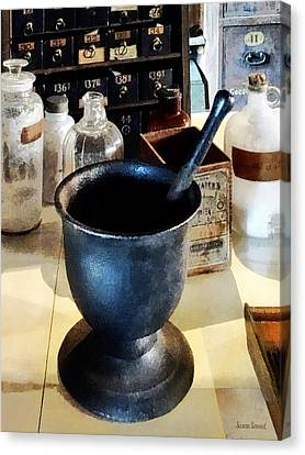 Medicine Canvas Print - Mortar And Pestle Near Medicine Bottles by Susan Savad