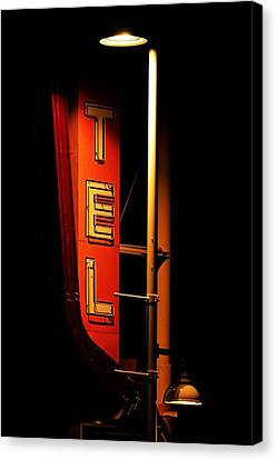 Canvas Print featuring the photograph Motel Sign At Night by Daniel Woodrum
