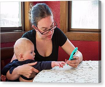 Mother And Baby Using A Mobile Device Canvas Print