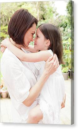 Mother And Daughter Hugging Canvas Print by Ian Hooton